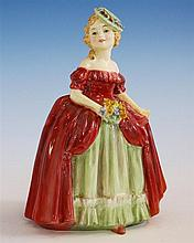 A Royal Doulton figurine 'Dainty May', HN1639, charming figure by Leslie Harradine, issued 1936-1949, 6¼in. (15.9cm.) high.
