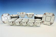A Shelley porcelain tea service 1920s, Queen Anne design with peach, grape and foliate decoration, comprising sucrier,