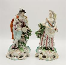 A pair of Derby porcelain figures of musicians late 18th century, comprising a cloaked dandy playing a pipe and holding a drum,