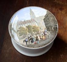 A Victorian Pratt ware pot lid Cathedral scene with figures to front, with base.
