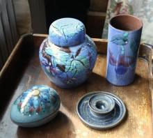 Three pieces of Guernsey Pottery and a Sark Pottery candlestick. (4)