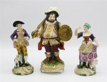 A Bloor Derby porcelain figure of the actor John Quin as Falstaff 9½in. (24.2cm.) high; together with a pair of Derby style porcelai...