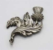 A Scottish silver thistle plate or brooch marked D. & G. Moey and Co. to reverse, early 20th century, 4in. (10.2cm.) long.