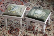 A pair of Victorian mahogany footstools with floral needle point seats, on four short supports, overpainted in light pink. (2)