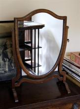 A Georgian style mahogany shield shaped swing mirror, c.1900