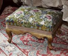 A 19th century carved gilt wood foot stool