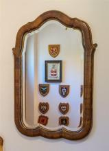 A Queen Anne style walnut mirror Victorian, the shaped cushion frame with gilt borders, around the original bevelled plate,