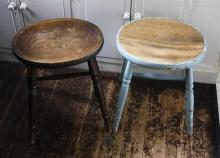 Two 19th century elm stools one painted, oval concave seats on turned supports with ''H'' stretcher, 18in. (45.8cm.) high. (2)