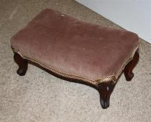 A small Victorian walnut foot stool rectangular with corduroy upholstered seat on four short cabriole legs with scroll feet,