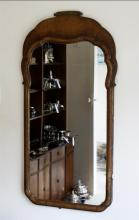 A Queen Anne style walnut mirror 19th century, rectangular form,