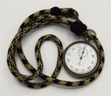 A military issue Swiss made stop watch early 20th century, white metal cased, enamel dial with subsidiary seconds dial.