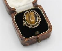 An Edwardian rose gold & tiger''s eye ring