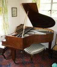 A walnut cased baby grand piano by Carl Hoffman, Wein 1920s-30s, with lyre form two pedal platform,