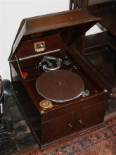 An H.M.V. 103 mahogany table top gramophone 1920s-30s, rectangular form, the deep lid with concave sides,