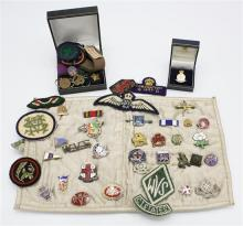 A collection of cloth and pin badges, some military some first half 20th century, including a WVS CI States cloth badge,