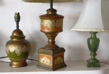 Two Oriental style earthenware lamps together with a green stained alabaster lamp. (3)