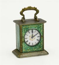 A good French miniature enamelled mantel clock late 19th century, signed Brevet to base, with scrolled gilt cast handle to top,