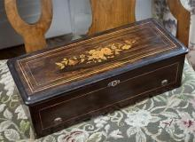A Victorian Swiss rosewood and marquetry musical box hinged lid with framed floral marquetry, ebonised interior, playing eight airs,