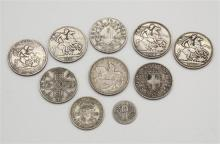 A small collection of silver coins including two Victorian crowns (1892 milled edge,