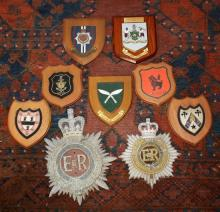 Seven wooden wall plaques including regimental plaques for the Brigade of Gurkhas and RCT, plus WRNS,