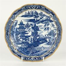A blue and white transfer print pattern shallow bowl late 19th century, scalloped gilt rim over stylised border,