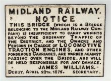 A cast iron station sign ''Midland Railway Notice'' warning of bridge weight restrictions, white ground with raised black lettering,