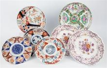 A Chinese Canton plate, two ''Emerald Flowers'' plates and four Imari plates largest 10¼ in. diameter. (7)