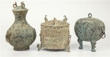 Three archaic style Chinese vessels with verdi gris patination possible shipwreck finds, tallest 10¼in.(26cm.) high. (3)