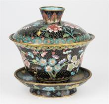 A Chinese cloisonné bowl, cover and stand polychrome floral decoration on black ground, turquoise enamelled interior,