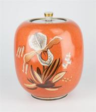 A Royal Copenhagen orchid decorated jar and cover c.1936, crackle glaze on orange ground,