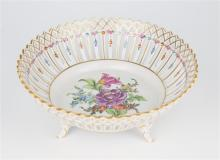 A Dresden porcelain floral sprigged reticulated basket 20th century, raised on four feet, polychrome and gilt floral decoration,