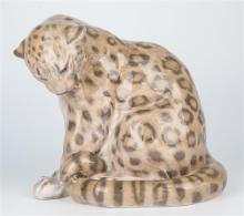 A Royal Copenhagen figure of a panther c.1953, no.2555, designed by Knud Kyhn, 8¼in. (21cm.) high.