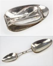 A Continental silver folding double ended medicine spoon early 20th century, symmetrically pierced waist section,