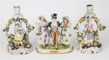 A Meissen style figure depicting a top-hat and tailed dandy gentleman with two female companions,