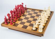 A Chinese export ivory ''Burmese'' pattern chess set 19th century, with carved red stained and natural ivory pieces,