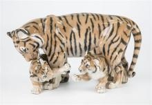 A Royal Copenhagen porcelain tiger and cubs no.4687, 5¾h x 10w.in. (14.5 x 25.4cm.)