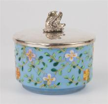 An early 19th century Bohemian blue glass pot with painted floral decoration, gilt metal rim, silver plated lid with stork finial,