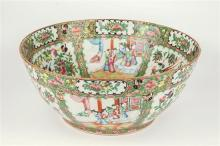 A large 19th century Cantonese famille rose bowl with alternating panels of stylised figural,