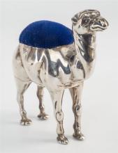 An Edwardian silver novelty camel pin cushion Adie & Lovekin Ltd., Birmingham 1905, with blue velvet pad hump, 2½in. (6.3cm.) high,