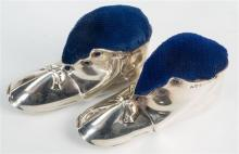 A matched pair of novelty boot form silver pin cushions Cohen & Charles and Levi & Salaman, Birmingham 1906,
