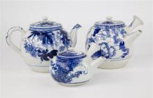 Three blue and white Oriental teapots two of globular form, one with short curved spout and scroll handle,