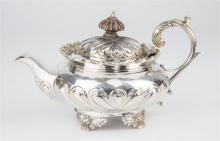 A rare late Georgian silver saffron teapot unmarked, hinged domed gadrooned decorated lid with petal carved wooden finial,