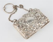 An Edwardian silver ring purse Birmingham 1903, repousse scrolling foliate decorated hinged panels with avian subjects also depicted,