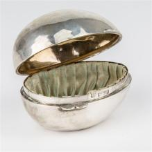 A novelty silver ring box Edwardian, Chester 1909, of egg form,