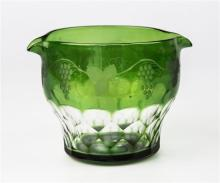 A Georgian green glass rinser squat ovoid form with tapering faceted lower section, trailing vine and fruit etching,