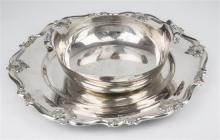 A silver plated salver scalloped rim with foliate pendants together with a plated bowl by Cohr of Denmark. (2)