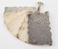 A late-Victorian silver aide-mémoire c.1900, with scrolling fern chasework, five ivory leaves, propelling pencil with bloodstone seal,
