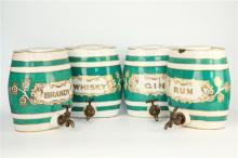 A set of four Staffordshire spirit casks bearing faux gilt labels. (4)