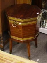 A George III mahogany cellarette circa 1790, octagonal brass bound wine cooler with lead lining, hinged brass handles to sides,