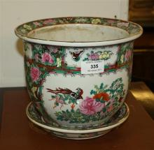 A Cantonese style jardinière ovoid form with everted rim and stylised panel decoration, with conforming dish, 10in. (25.4cm.) high,